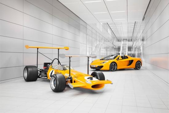 A 1969 McLaren M7C sits alongside todays 12C Spider