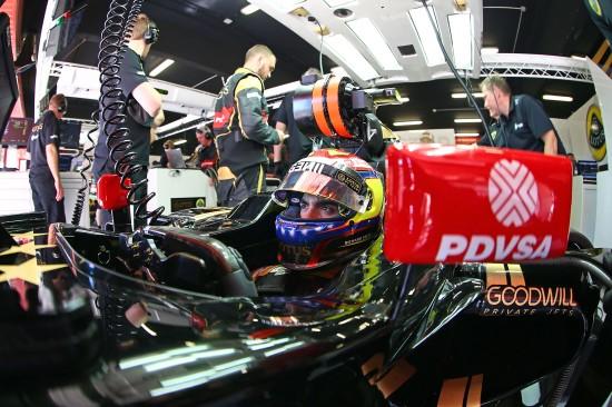 Great shot of Pastor Maldonado in the pit garage.