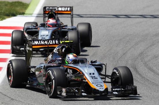 Sergio Perez leads team mate Nico Hulkenberg.