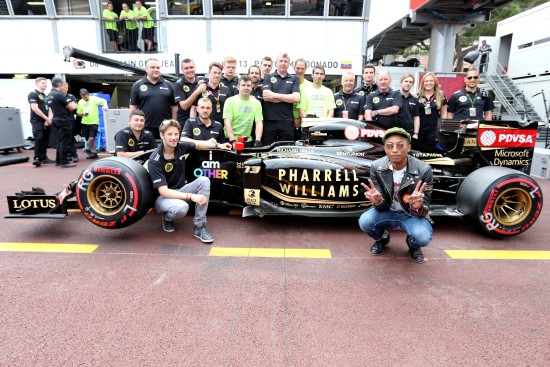 Romain Grosjean (FRA) Lotus F1 E23 with Pharrell Williams (USA) Singer-Songwriter. Monaco Grand Prix, Sunday 24th May 2015. Monte Carlo, Monaco.