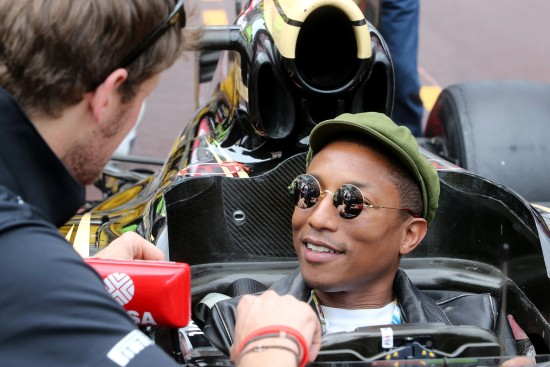 Pharrell Williams (USA) Singer-Songwriter with Romain Grosjean (FRA) Lotus F1 Team and the Lotus F1 Team team. Monaco Grand Prix, Sunday 24th May 2015. Monte Carlo, Monaco.