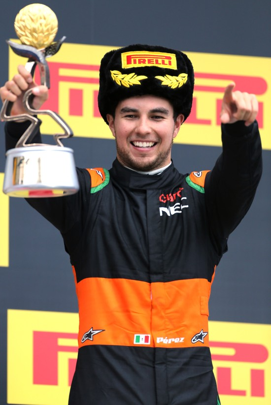 Sergio Perez celebrates his third position on the podium.