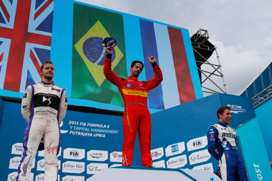 Brazil's Lucas Di Grassi (ABT Audi Sport FE01) celebrates on the podium with Sam Bird (DS Virgin Racing DSV-01) and Robin Frijns (Andretti - Spark SRT_01E). Photo: Zak Mauger/LAT