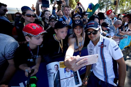 Albert Park, Melbourne, Australia. Sunday 20 March 2016. Felipe Massa, Williams Martini Racing, has his photo taken with fans. Photo: Glenn Dunbar/Williams F1 ref: Digital Image _W2Q3072
