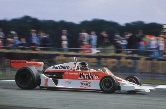 1977 British Grand Prix. Silverstone, England. 14th - 16th July 1977.  James Hunt (McLaren M26-Ford), 1st position, action. World Copyright: LAT Photographic. Ref: 77 GB 02.