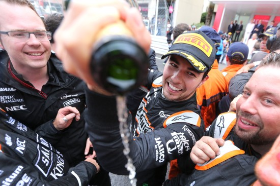 Sergio Perez (MEX) Sahara Force India F1 celebrates his third position at the podium with the team. Monaco Grand Prix, Sunday 29th May 2016. Monte Carlo, Monaco.