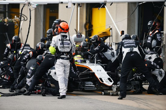 Sergio Perez makes a pit stop.