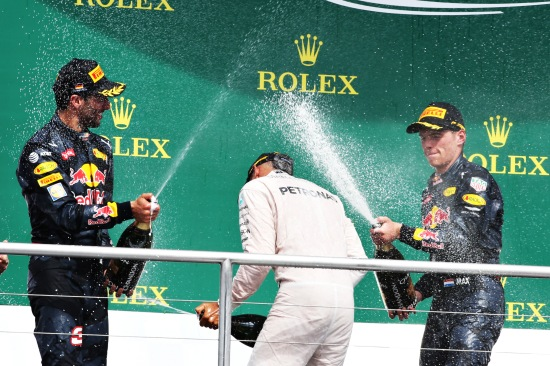 Daniel Ricciardo, Max Verstappen, and Lewis Hamilton celebrate on the podium.