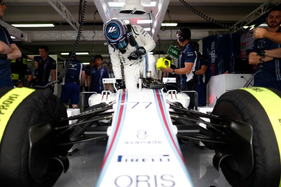 Valtteri Bottas climbs in to his car.